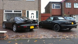 The RX-7 and MX-5 ('Maggy') grace the driveway